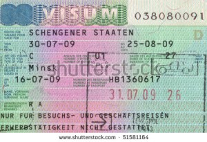 stock-photo-schengen-visa-in-passport-and-polish-customs-stamp-51581164