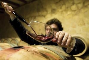 Ricardo Penalba prepares to taste a wine at Penalba's winery in Aranda de Duero, northern Spain